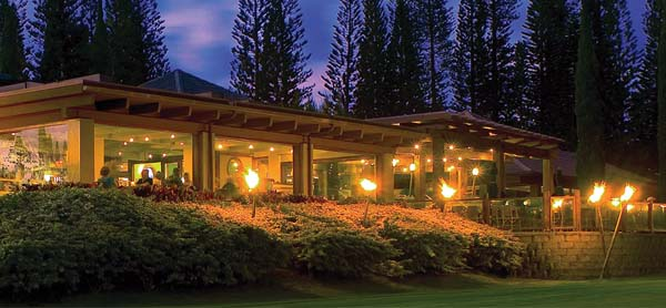 The landmark Kapalua restaurant at night dishes up sunset views through the Cook Pines. Pineapple Grill photo