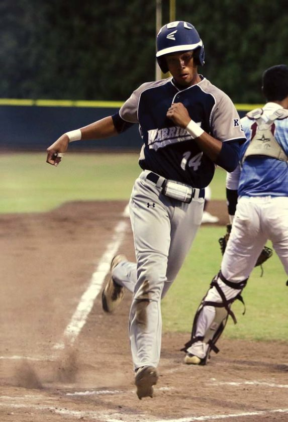 Kamehameha Maui's Nate Facuri scores in the first inning.   The Maui News / CHRIS SUGIDONO photo
