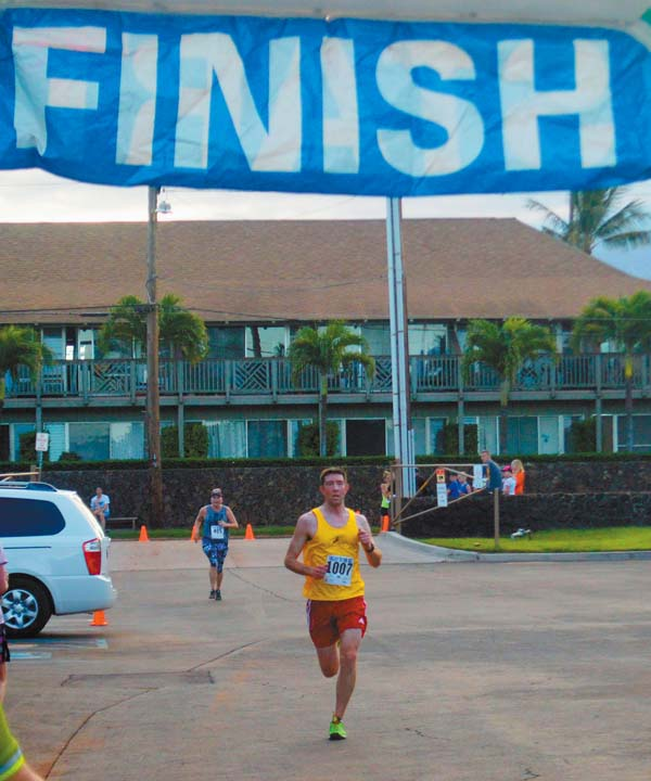 Eric Monda of Colorado arrives at the finish line to take second place in the 10K. The Maui News / BRAD SHERMAN photo