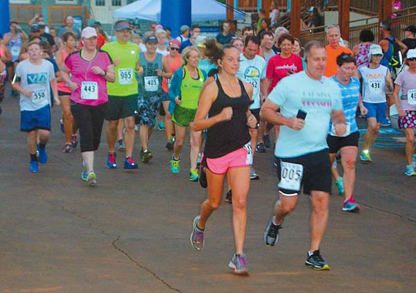 Runners in the Valley to the Sea 10-kilometer and 5-kilometer races take off from the starting line at the Hawaiian Islands Humpback Whale National Marine Sanctuary on Saturday. The Maui News / BRAD SHERMAN photo
