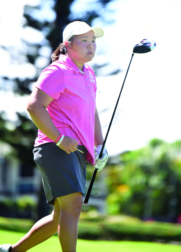 Utah Valley's Kaylee Shimizu, a Baldwin graduate, follows the flight of her drive off the 18th tee. • The Maui News / MATTHEW THAYER photo