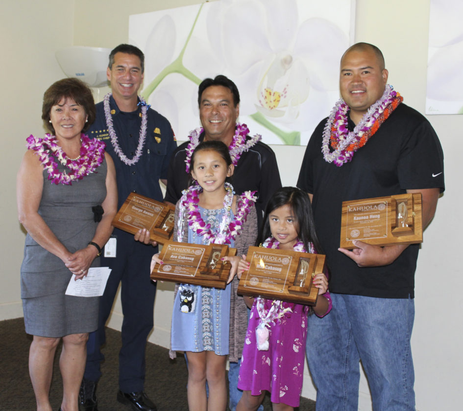 Four people were honored by the Maui Fire Department on March 16 as heroes for saving lives. The recipients of the Kahuola Award are (front row from right) Mia and Ava Cabasug and (back row from right) Kaunoa Hong and George Awana. Also in the photo are Doreen Canto, Maui County Fire & Public Safety Commission chairwoman, and Fire Chief Jeff Murray.