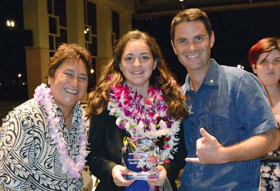 Boys & Girls Clubs of Maui Chief Executive Officer Kelly Pearson (left) and Director of Operations Maurice Bajon (right) congratulate the 2017 Youth of the Year Amanda Caires. Caires represented the Makawao clubhouse.