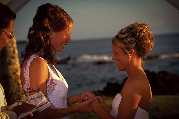 Emily and Deanna Anderson hold a wedding ceremony at the White Orchid Beach House in Makena in September 2010. Same-sex marriage was not legalized by Hawaii until 2013, and after an initial flurry the same-sex wedding business has become more steady, according Carolee Higashino, owner of White Orchid Wedding and the LGBT-focused Purple Orchid Wedding. -- TAD CRAIG photo