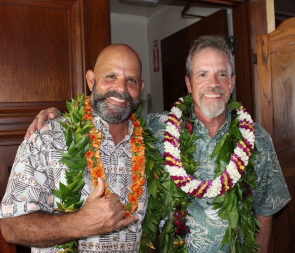Kimo's assistant GM Jack Starr (left) and GM Chris Almeroth celebrate the Lahaina restaurant's 40th anniversary recently. •  Photo courtesy Kimo's
