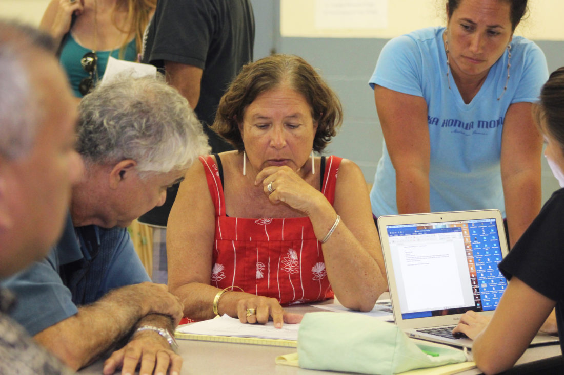 Davianna McGregor (center) discusses a proposed community-based subsistence fishing area on Molokai's north shore with residents during a meeting Wednesday night at Maui Waena Intermediate in Kahului. •  The Maui News COLLEEN UECHI photo
