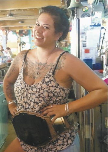 Bartender Ginny Block of Spanky's Riptide won the recent fun cocktail contest at Down The Hatch in Lahaina. She is wearing her winning belt. The restaurant will present a scavenger hunt April 20. * Photo courtesy Down the Hatch