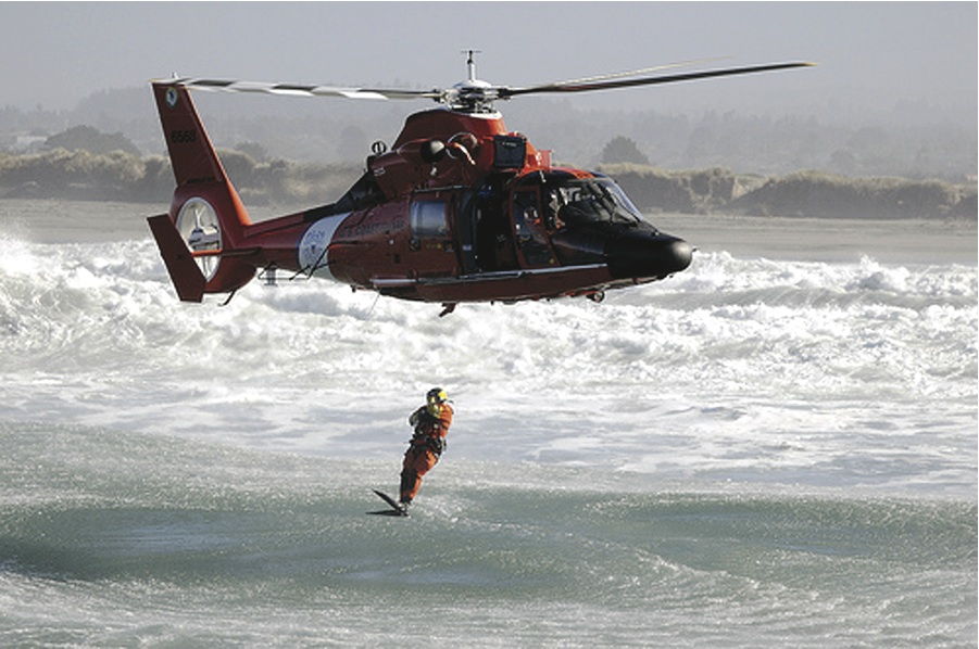 The U.S. Coast Guard is recruiting Maui surfers and water polo players to apply for helicopter rescue swimmer jobs. * U.S. Coast Guard photo