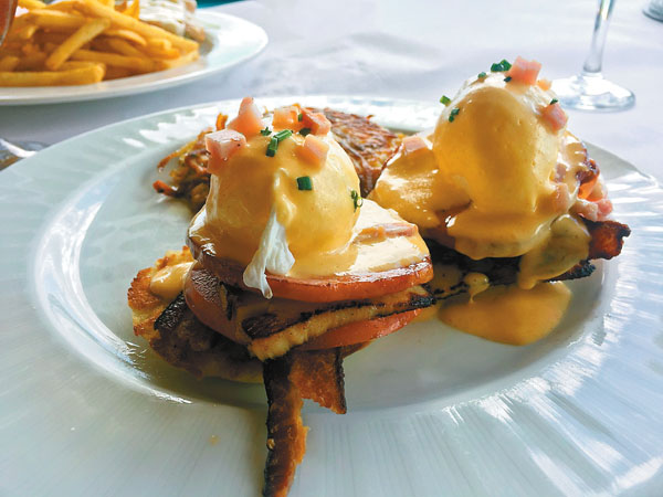 """The Club"" eggs Benedict is topped with smoked bacon, turkey, Canadian bacon and vine ripe tomatoes at Sarento's on the Beach's new Brunch Every Day from 7 a.m. to 3 p.m. in its oceanfront spot in Kihei. Photo courtesy Sarento's on the Beach"