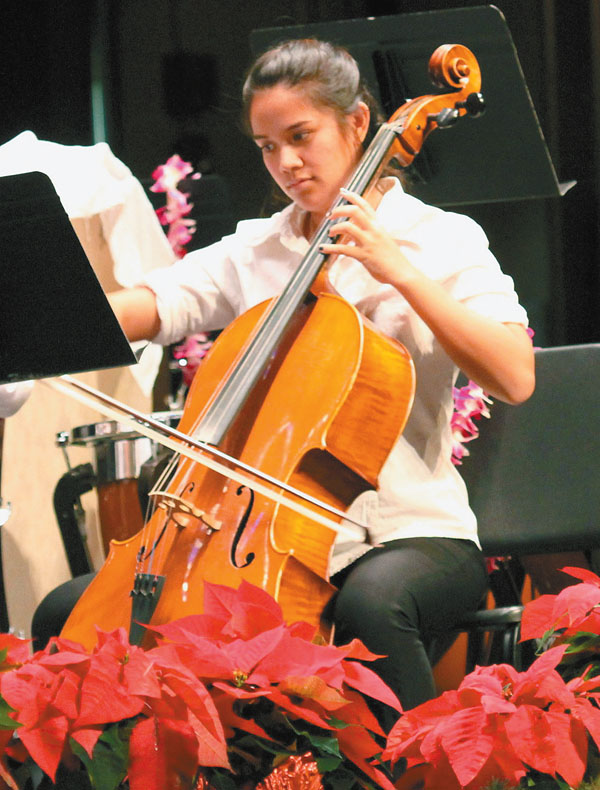 Kayla Bisquera plays the cello with the Maui Youth Philharmonic Orchestra under the direction of Lance Jo • Sunday; photo by Fumi Mutzenberg.