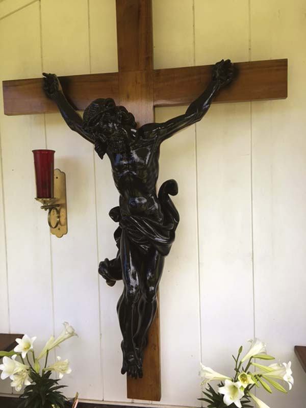 Vandals spray-painted a crucifix black between Tuesday afternoon and Wednesday morning at St. Rita Church in Haiku. Church officials plan to remove, restore and return the crucifix to its place in a shrine on the church property.