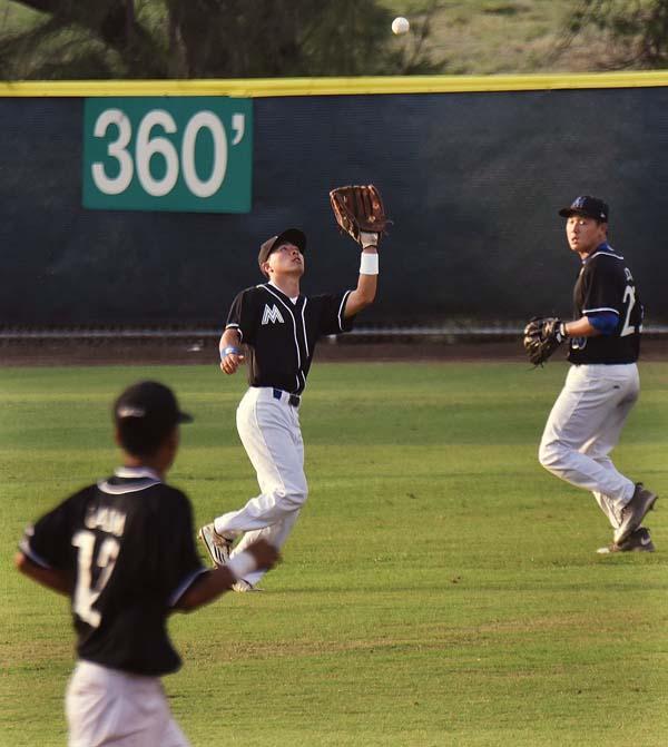 Maui High center fielder Micah Jio settles under a third-inning fly ball between shortstop Jyrah Lalim and right fielder Orrion Suda. The Maui News / MATTHEW THAYER photo