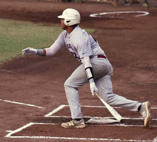 Baldwin's Nainoa Keahi follows through on a first-inning single. The Maui News / MATTHEW THAYER photo