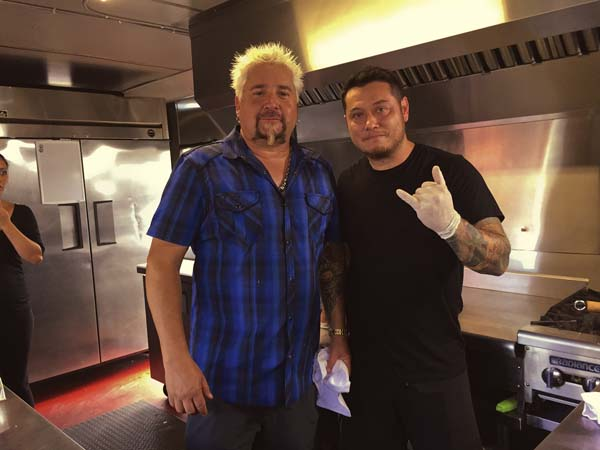 Tom Sribura, chef and owner of Thai Mee Up, hangs out with TV show host Guy Fieri during Fieri's visit to the Kahului food truck earlier this month. Thai Mee Up photo