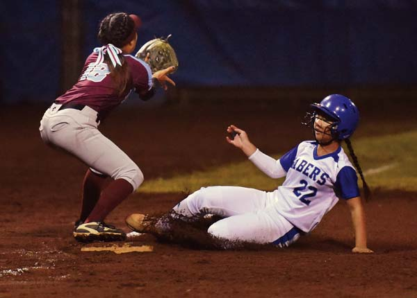 Maui High School's Erin Prieto slides into third base in the second inning as Baldwin's Bryana Yoshida awaits the throw. The Maui News / MATTHEW THAYER photo