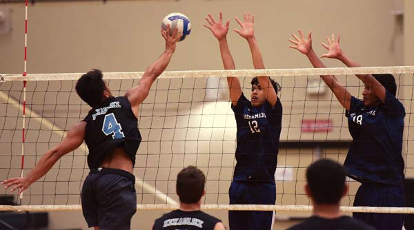 King Kekaulike's Zayden Mokiao attempts a second-set shot against Kamehameha Maui's Haweo Johnson and Rafael Adolpho on Thursday. The Maui News / MATTHEW THAYER photo
