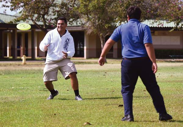 Kawehi Raboy-McGowan (left) and Ryan Aipa play with a flying disc Wednesday afternoon during the Big Brothers Big Sisters of Maui after-school mentoring program at Kamehameha Schools Maui. Raboy-McGowan, a Kamehameha Maui senior, has been accepted to a variety of top-tier schools, including Harvard and Stanford. -- The Maui News / MATTHEW THAYER photo