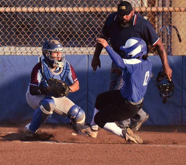 Baldwin catcher Saree-Ann Kekahuna sets to tag out Maui High's Kaimi Lay Fuentes in the third inning Tuesday. The Maui News / MATTHEW THAYER photo