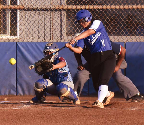 The Sabers' Destiny Kama hits a third-inning RBI single to right field. The Maui News / MATTHEW THAYER photo
