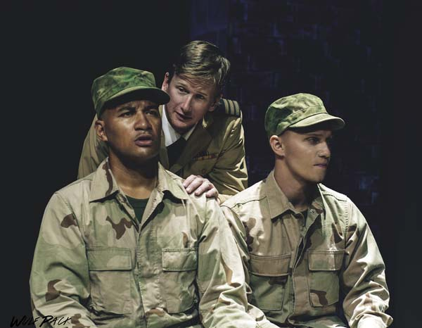 "Reuben Carrion (from left), Ricky Jones and David Tuttle put military mentality and the Marine code of honor on trial at the Maui premiere of Aaron Sorkin's ""A Few Good Men."" Performances are 7:30 p.m. Fridays and Saturdays, and 3 p.m. Sundays, April 28 through May 14 at the Historic Iao Theater in Wailuku. Tickets range from $20 to $40. Call 242-6969 or order online at www.mauionstage.com. Brett Wulfson photo"