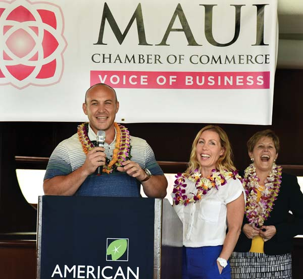 Maui Brewing Co. President/CEO Garrett Marrero (from left) gets a laugh out of wife and company Vice President/COO Melanie Oxley and Jane Sawyer, district director of the U.S. Small Business Administration's Hawaii District Office, during his speech Wednesday afternoon at the King Kamehameha Golf Club. Marrero and Oxley were named this year's 2017 Small Business Persons of the Year for Hawaii award and were honored at the Maui Chamber of Commerce's 2017 annual Maui Small Business Administration Awards and Economic Update Luncheon. The Maui News / MATTHEW THAYER photo