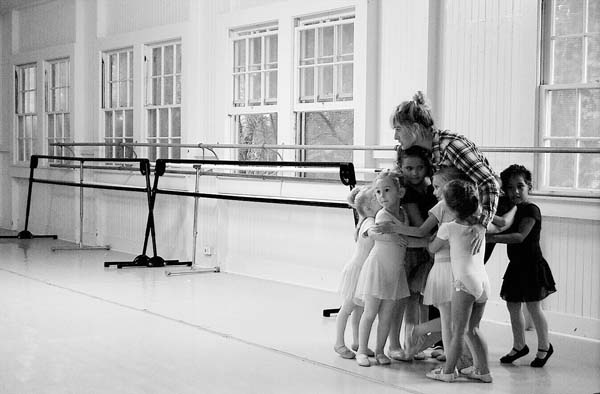 Hallie Hunt, a teacher at the Alexander Academy of Performing Arts, hugs a group of dance students at a studio in the Old Kula Community Center. The academy has until Monday to vacate the center, which the county has condemned because of chipping lead paint and the need to rebuild the whole structure. Alexander Academy of Performing Arts photo