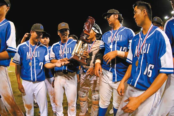 Members of the Maui High baseball team celebrate with the championship trophy Saturday night. @AndrewLeeHI / ANDREW LEE photo