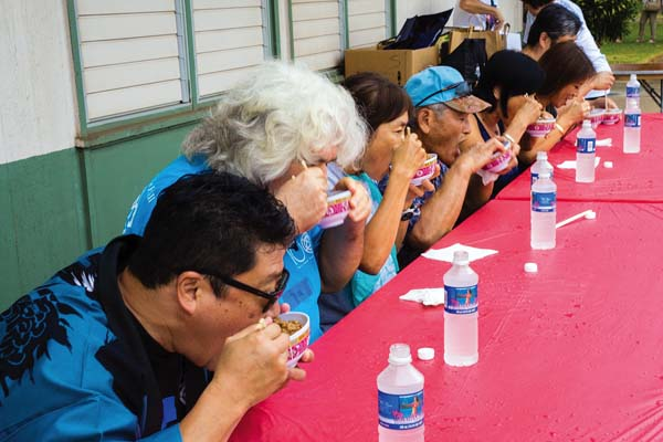 Contestants in Maui Matsuri's Natto Eating Contest; photo by Melanie Agrabante.