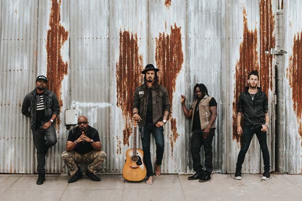 Michael Franti (center) and Spearhead bring their socially conscious music to the MACC. Chelsea Klette photo
