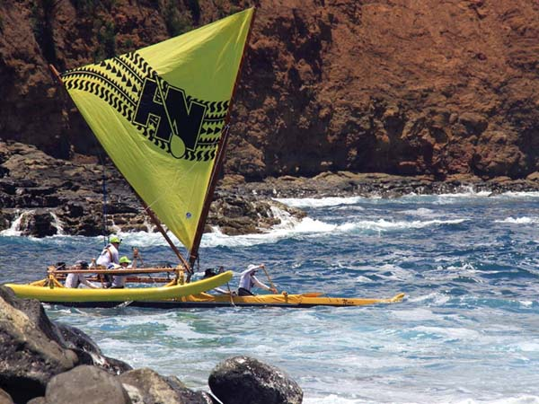 Noio takes off from Keokea Park on the way to winning the traditional-class division of Saturday's Hawaiian Sailing Canoe Association race from the Big Island to Hana. The Oahu-based canoe, captained by Jamie Brown, had a time of 3 hours, 40 minutes. GLORIA REED photo