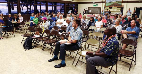 About 50 Upcountry residents listen to Kaiser Permanente officials speak Wednesday night at the Kula Community Center on the transition of Maui County's three public hospitals to Kaiser. The Maui News / CHRIS SUGIDONO photo
