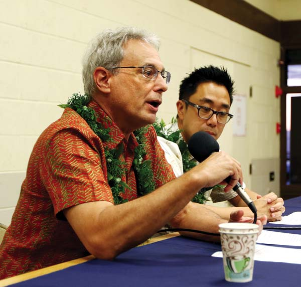 Kaiser Chief Medical Director Dr. David Ulin speaks to Upcountry residents Wednesday night alongside Ray Hahn, senior vice president and area manager of Kaiser's Maui Health System, at the Kula Community Center. The Maui News / CHRIS SUGIDONO photo