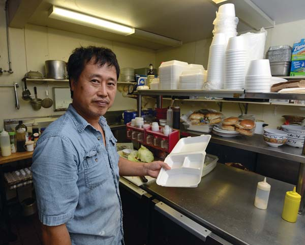 "Millyard Hamburger Steak House owner Ezra Ka uses about 1,000 polystyrene containers a month in his Wailuku eatery and says he is not looking forward to buying a more expensive alternative. ""It will hurt small business. Everything is getting a higher price. Styrofoam is a great invention, they don't have to take it away. You've got to educate people. Let people use; if they misuse, enforce the law. I know there is an environmental concern, I just wish they would find balance."" The Maui News / MATTHEW THAYER photo"