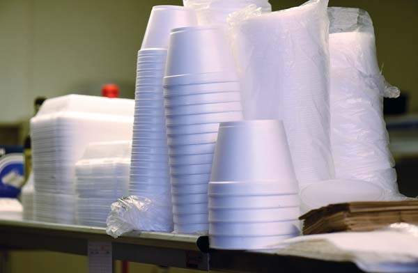 Polystyrene containers are stacked at Millyard Hamburger Steak House on Wednesday afternoon. A measure banning the use of polystyrene foam food containers was approved by the County Council on Thursday evening. The Maui News / MATTHEW THAYER photo