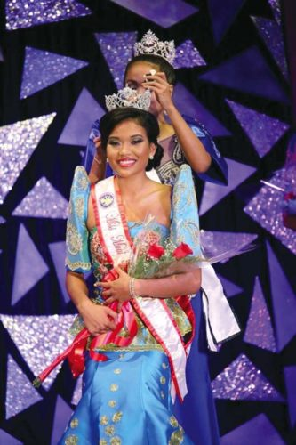 Kimberly Yap was crowned Miss Maui Filipina 2017 on May 13. Presenting the crown is Miss Maui Filipina 2016 Ashlyne Rosalin. -- REY PATAO photo