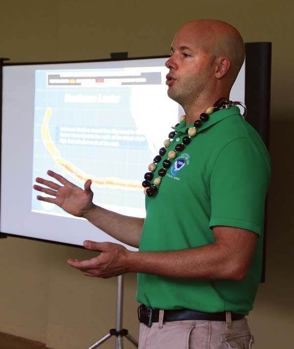 Jon Jelsema, senior forecaster and hurricane specialist for the National Weather Service in Honolulu, speaks to about 20 West Maui residents Thursday night at Lahaina Civic Center amphitheater. -- The Maui News / CHRIS SUGIDONO photo