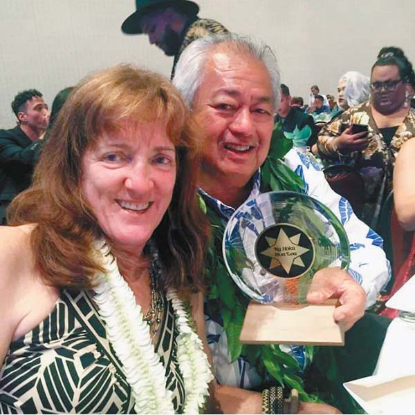 George Kahumoku Jr. and his wife, Nancy, pose with his Na Hoku Hanohano Award for Christmas Album of the Year on Saturday on Oahu. Photo courtesy of George Kahumoku Jr.
