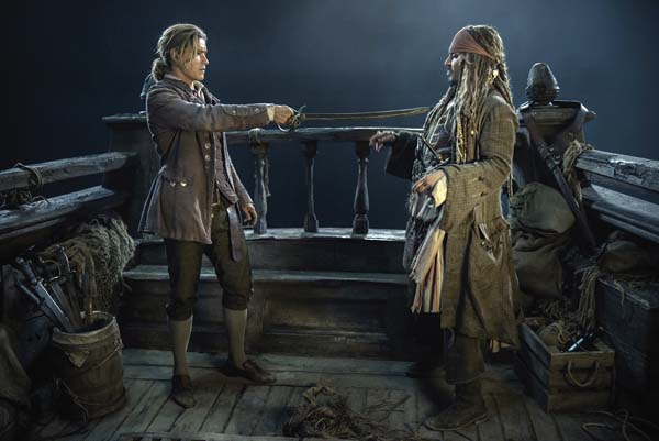 "Brenton Thwaites as Henry Turner (left), and Johnny Depp as Jack Sparrow in  ""Pirates of the Caribbean: Dead Men Tell No Tales."" Disney photo via AP"
