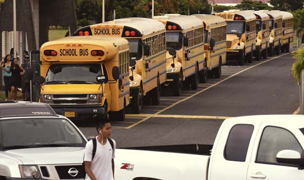 School buses are lined up in front of Maui High School at the end of classes Tuesday afternoon. A new bus company, Ground Transport, will be providing bus service for these students next school year. The Maui News / MATTHEW THAYER photo