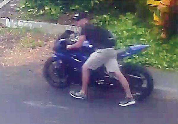 This surveillance photo shows someone taking a blue 2006 Yamaha motorcycle at about 6:40 p.m. Wednesday from the Grand Wailea Resort parking area.