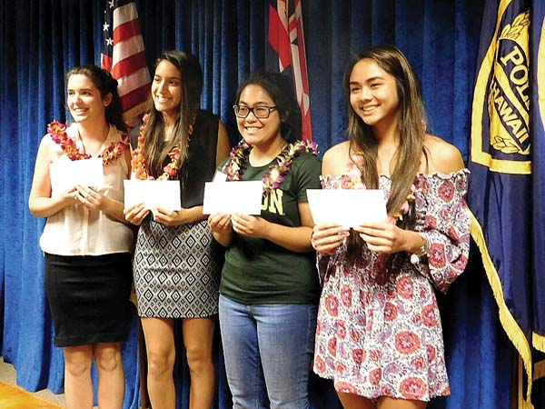 Kamryn Perry (from left), Lacey Santos, Rachel Nagamine and Sadie Ansai receive $1,000 scholarships from the Maui Police Relief Association on May 15. -- The Maui News / LILA FUJIMOTO photo