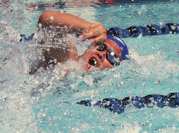 Maui Swim Club's Kiakahi Matsumoto competes in men's open 50-meter freestyle Saturday during the Coach Soichi Sakamoto Memorial Invitational at Sakamoto Pool. -- The Maui News / MATTHEW THAYER photo