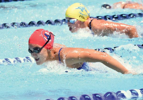 Maui Swim Club's Kaimi Matsumoto and the Maui Dolphins' Ana Eyre swim in the girls 15-16 200 individual medley — Matsumoto won, and Eyre finished second. -- The Maui News / MATTHEW THAYER photo