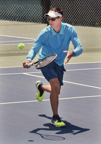 Rick Camp hits a second-set return while teaming with Rob Davidson for a win at 4.5 men's doubles Saturday in the Wailea Open on Saturday at Wailea Tennis Club. The tournament continues through Monday. -- The Maui News / MATTHEW THAYER photo