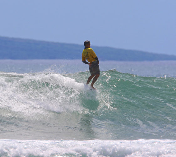 Eric Casco heads to a win in the Kimo's Rob Thibaut Memorial Longboard Contest on Saturday at Mala Wharf. Zane Schweitzer was second in the 40th edition of the event. DOOMAPHOTOS photo