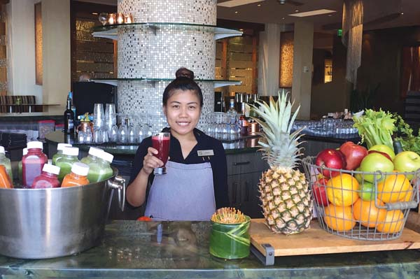 Just Juice bar hostess Nerissa Lim serves one of many island fresh drinks at the new pit stop for walkers and beach goers at Ko in Fairmont Kea Lani resort in Wailea. Fairmont Kea Lani photo