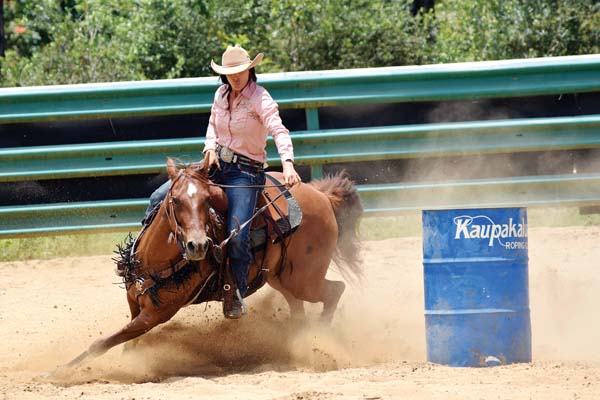 Rachel Andrews makes a turn on the way to a barrels win in the Kaupakalua Roping Club Memorial Day Rodeo that took place Saturday and Sunday at Kaupakalua Arena in Haiku. EMY-JO FERGUSON photo