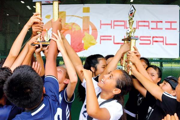 The FA Maui 2005 boys and girls teams celebrate Monday after winning titles in the Hawaii Futsal State Championships at the Pane'ewa Covered Playcourts in Hilo. -- TRISHA KAPUA'ALA photo