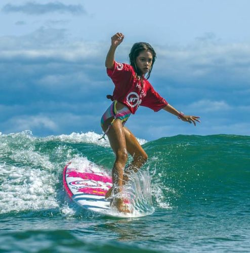 Chrislyn Simpson-Kane heads to a win in the girls longboard division during Saturday's Pohai Na Keiki Nalu (Gathering of the Surf Kids) on Saturday at Launiupoko Beach Park in Lahaina. -- 1morephotography.com / DAYANIDHI DAS photo