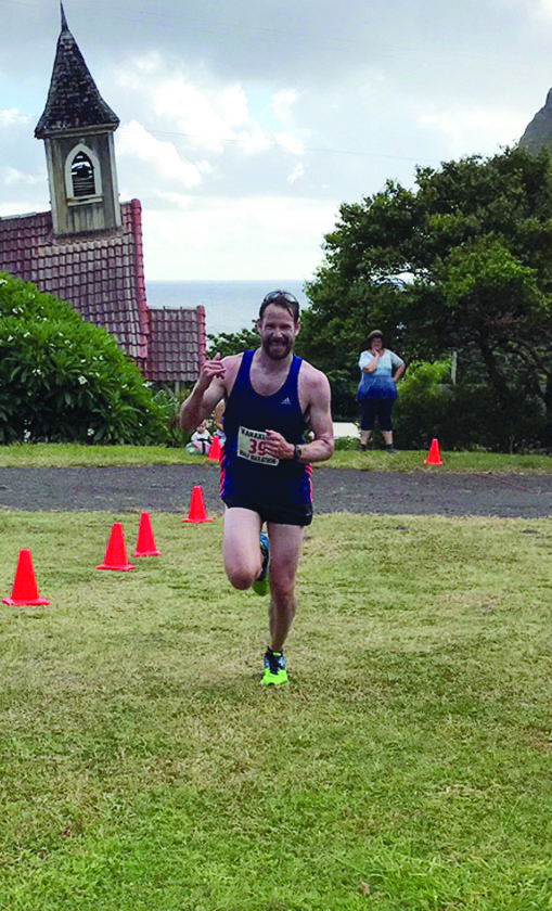 Evan Fox of Makawao celebrates as he approaches the finish line to win the Kahakuloa Half Marathon on Saturday. Fox finished in 1 hour, 28 minutes, 13 seconds. • KALEO LI photo